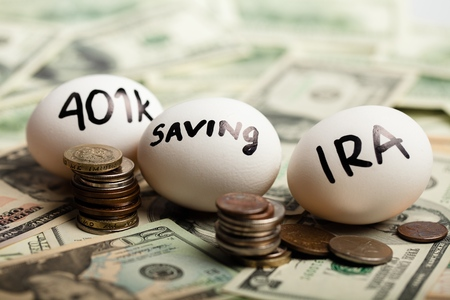 Foto de Start Thinking About Your Retirement - Nest Eggs On Dollar Bills - Imagen libre de derechos