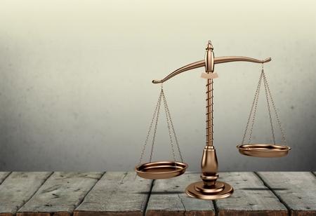 Photo pour Law scales on table. Symbol of justice. Vintage sepia photo - image libre de droit