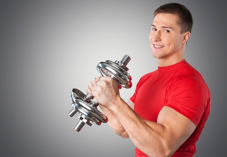 Photo for Happy Senior with Dumbbells - Royalty Free Image