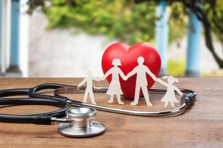 Foto de Medical Insurance Concept With Family - Imagen libre de derechos