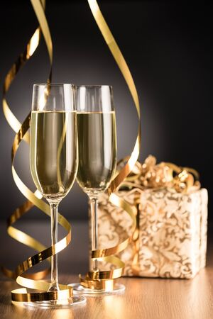 Photo for Champagne Glasses with Streamers and Gift Box - Royalty Free Image