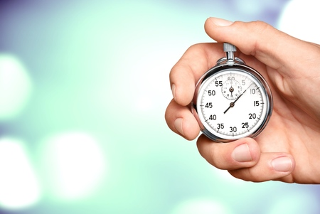 Foto per Close-up Stopwatch in Human Hand, Timer - Immagine Royalty Free