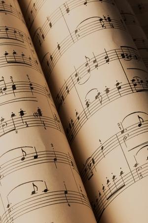 Photo pour Rolled Up Music Notes Pages Close-Up - image libre de droit