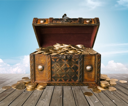 Photo for Open treasure chest filled with gold coins isolated on white - Royalty Free Image