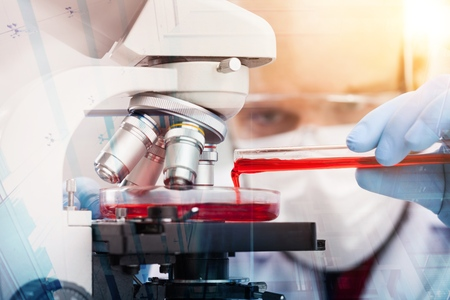 Foto de scientist with equipment and science experiments ,Laboratory glassware containing chemical liquid, science research,science background and science concept and selective focus. - Imagen libre de derechos