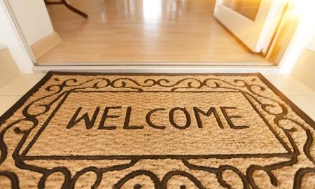 Foto de Blank doormat before the door - Imagen libre de derechos