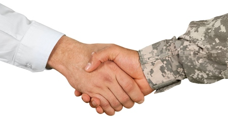 Photo for Soldier and Businessman Shaking Hands - Royalty Free Image