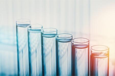 Foto de Laboratory research, dropping liquid to test tube - Imagen libre de derechos