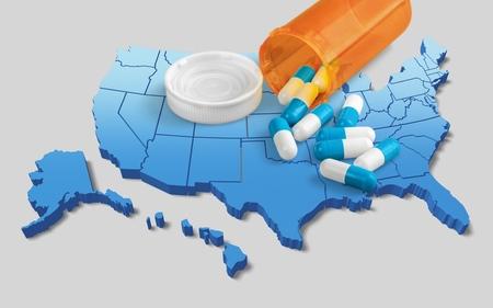 Foto de White prescription pills on map - Imagen libre de derechos