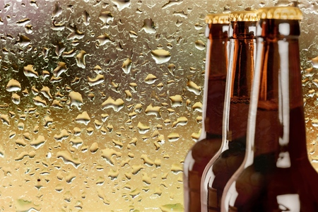 Photo for Upper part of three beer bottles - Royalty Free Image