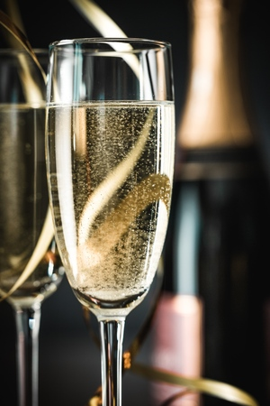 Photo for Champagne Glasses and Bottle with Streamers - Royalty Free Image