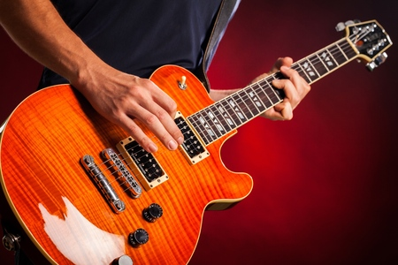 Photo for Closeup of a Musician Playing an Electric Guitar - Royalty Free Image