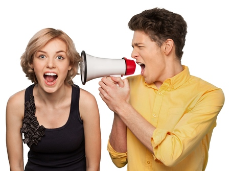 Photo pour Angry young couple with megaphone isolated on white background - image libre de droit