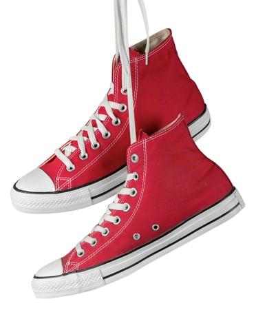 Foto de Pair of Hanging Red Shoes - Imagen libre de derechos