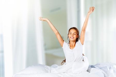 Foto de Happy healthy woman back view waking up - Imagen libre de derechos