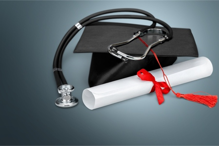 Photo for Graduation hat with tassel, diploma with red - Royalty Free Image