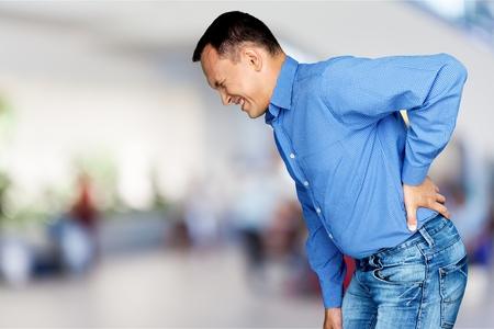 Foto de Mature man with backache isolated on white background - Imagen libre de derechos