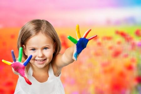 Foto de Cute little girl with colorful painted hands on white background - Imagen libre de derechos