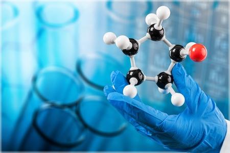Photo pour Scientist man  holding molecule form isolated on background,close up - image libre de droit