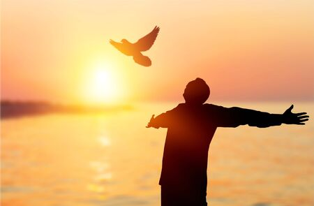 Photo pour Happy man rise hand on morning view. Christian inspire praise God on good friday background. Now one man self confidence on peak open arms enjoying nature the sun concept world wisdom fun hope - image libre de droit