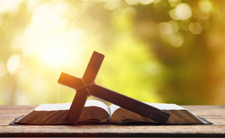 Photo for Holy Bible on the background of the Christian cross and the life-giving divine light. The hope of mankind for salvation. The way to God through prayer. The Resurrection and Rapture of Jesus. - Royalty Free Image
