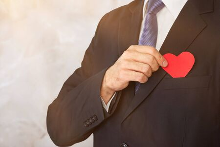 Foto de Businessman with red heart on left chest isolated on white background with clipping path. - Imagen libre de derechos