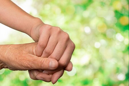 Photo for Hands of the old man and a young woman. close up. - Royalty Free Image