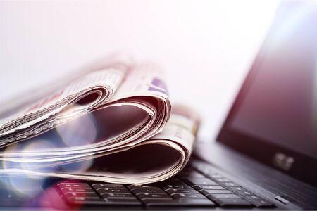 Foto de Newspapers on the laptop. Online news. Isolated - Imagen libre de derechos