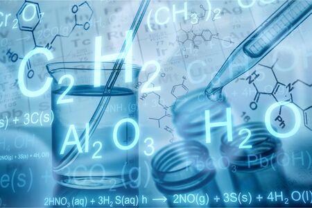 Foto de Laboratory Research, dropping chemical liquid to test tube with beaker - Imagen libre de derechos