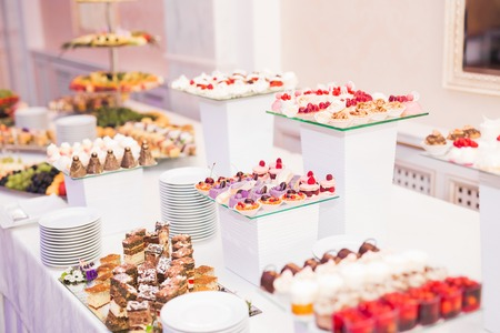 Foto de Delicious wedding reception candy bar dessert table. - Imagen libre de derechos