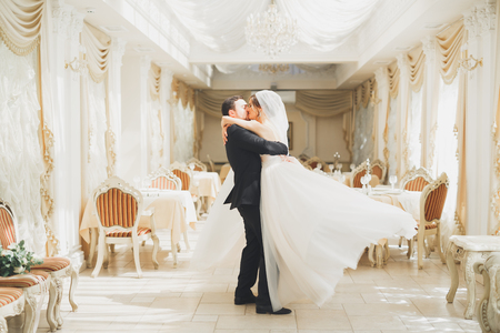 Photo for Romantic couple dancing and kissing on their wedding - Royalty Free Image