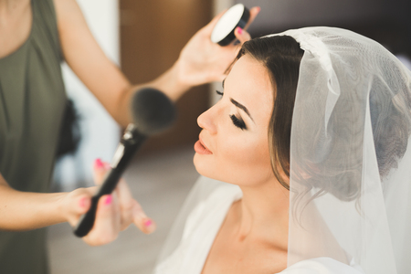 Photo for Makeup artist preparing bride to the wedding - Royalty Free Image