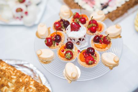 Foto de Delicious wedding reception candy bar dessert table. - Imagen libre de derechos