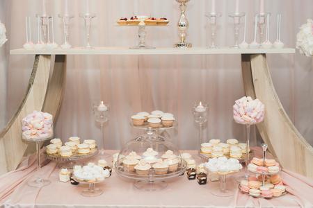 Foto de Delicious wedding reception candy bar dessert table - Imagen libre de derechos