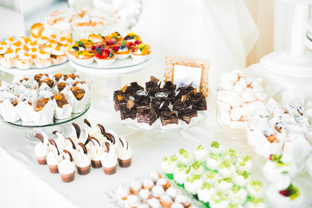 Foto de Delicious wedding reception candy bar dessert table - Imagen libre de derechos