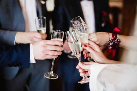 Foto de Gorgeous wedding couple enjoys champagne in the ceremony. - Imagen libre de derechos