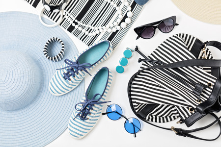 Photo for Fashion accessories in black and white and blue colors - hat clothing, shoes and bag, bracelets and glasses. - Royalty Free Image