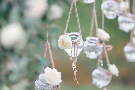 Photo pour Original wedding floral decoration in the form of mini-vases and bouquets of flowers hanging from the ceiling - image libre de droit