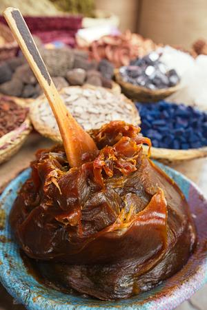 Foto de Moroccan Black Olive Hammam Soap in the Marrakesh street souk shop - Imagen libre de derechos