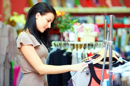 Foto de pretty elegant woman shopping in clothes store - Imagen libre de derechos