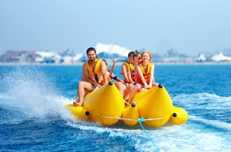 Photo for happy people having fun on banana boat - Royalty Free Image