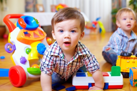 Photo pour curious baby boy studying nursery room - image libre de droit