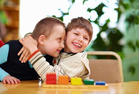 Foto de happy kids with disabilities in preschool - Imagen libre de derechos