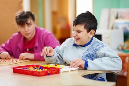 Foto de cognitive development of kids with disabilities - Imagen libre de derechos