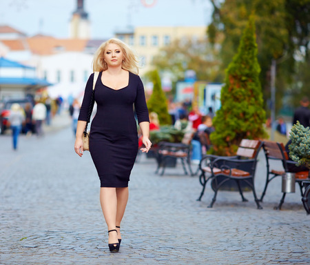 Photo for confident overweight woman walking the city street - Royalty Free Image