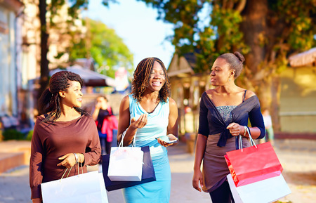 Photo for happy african girls walking the street with shopping bags - Royalty Free Image