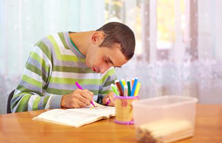 Foto de young adult man engages in self study, in rehabilitation center - Imagen libre de derechos