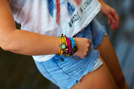 Foto de Colorful watch wristband on stylish female hand - Imagen libre de derechos