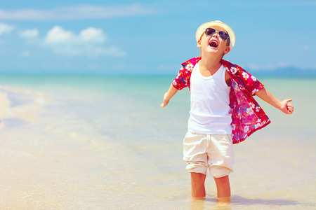 Photo for happy fashionable kid boy enjoys life on summer beach - Royalty Free Image