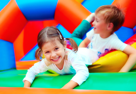 Foto de happy kids having fun on playground in kindergarten - Imagen libre de derechos